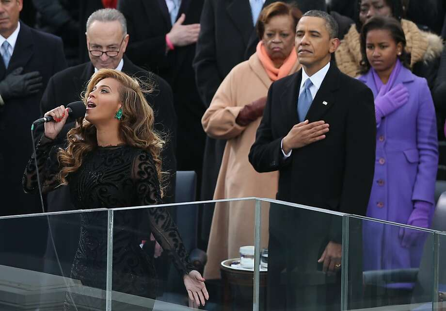 WASHINGTON, DC - JANUARY 21:  Singer Beyonce performs the National Anthem as U.S. President Barack Obama looks on during the public ceremonial inauguration on the West Front of the U.S. Capitol January 21, 2013 in Washington, DC.   Barack Obama was re-elected for a second term as President of the United States.  (Photo by Alex Wong/Getty Images) Photo: Alex Wong, Getty Images