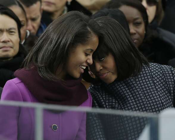First lady Michelle Obama speaks with her daughter Sasha at the ceremonial swearing-in for President Barack Obama at the U.S. Capitol during the 57th Presidential Inauguration in Washington, Monday, Jan. 21, 2013. (AP Photo/Pablo Martinez Monsivais) Photo: Pablo Martinez Monsivais, Associated Press