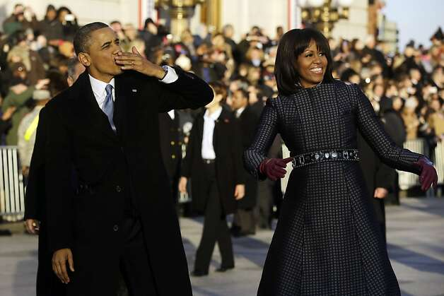 President Barack Obama blows a kiss as he and first lady Michelle Obama walk on Pennsylvania Avenue near the White House in the Inauguration Parade during the 57th Presidential Inauguration in Washington, Monday, Jan. 21, 2013. (AP Photo/Charles Dharapak) Photo: Charles Dharapak, Associated Press