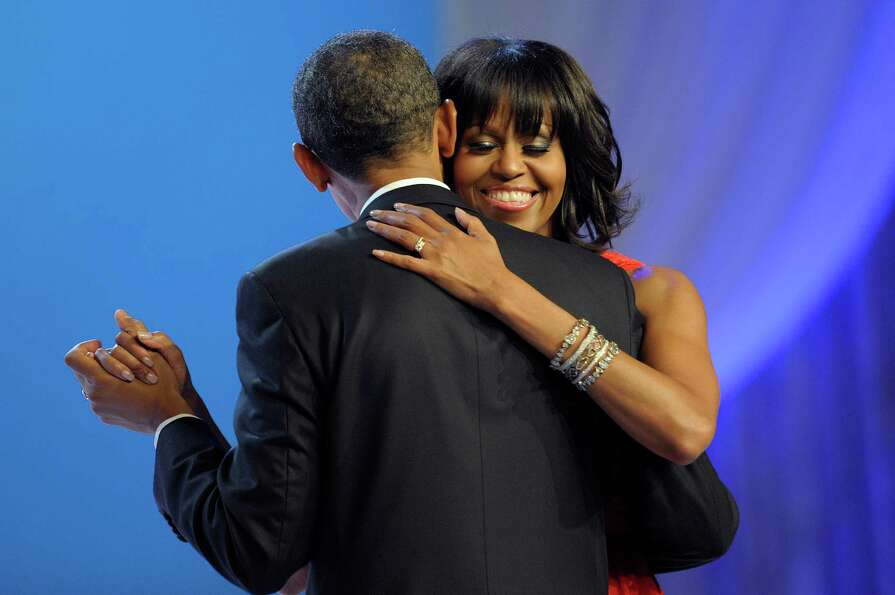 First lady Michelle Obama smiles has she dances with President Barack Obama during The Inaugural Bal