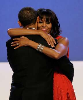 First lady Michelle Obama wraps her arms around President Barack Obama while dancing during the Inaugural Ball. Photo: AP