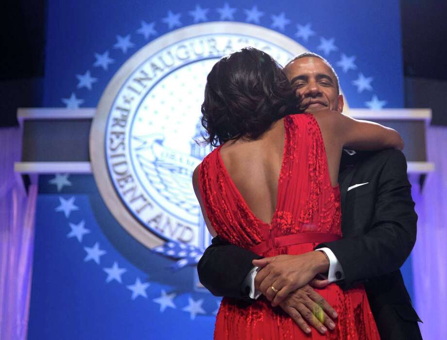 President Barack Obama holds first lady Michelle Obama as they dance at an Inaugural Ball. Photo: AP