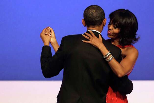 President Barack Obama and first lady Michelle Obama dance together at the Commander-in-Chief's Inaugural Ball. Photo: AP