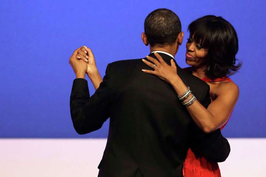 President Barack Obama and first lady Michelle Obama dance together at the Commander-in-Chief's Inau