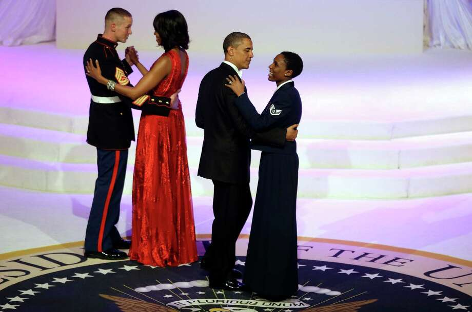 President Barack Obama and first lady Michelle Obama share a dance with Air Force Staff Sgt Bria Nelson and Marine Corps Gunnery Sgt. Timothy Easterling during the Commander-In-Chief's inaugural ball. Photo: AP