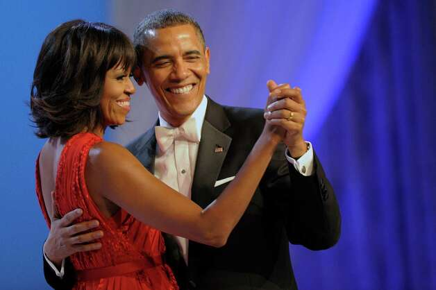 President Barack Obama dances with first lady Michelle Obama during The Inaugural Ball at the Washignton convention center during the 57th Presidential Inauguration in Washington, Monday, Jan. 21, 2013. Photo: AP