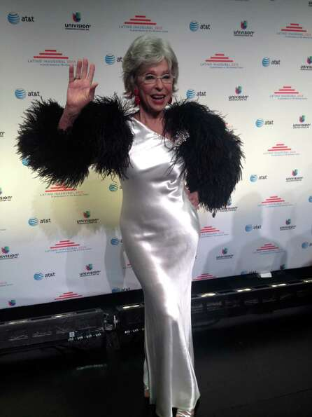 Actress Rita Moreno waves on the red carpet of the Latino Inaugural 2013 ball at the Kennedy Center.