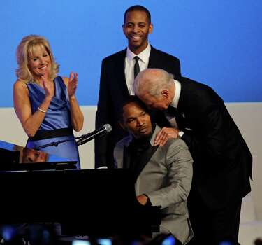 Vice President Joe Biden talks to Jamie Foxx as Jill Biden watches during The Inaugural Ball. Photo: AP