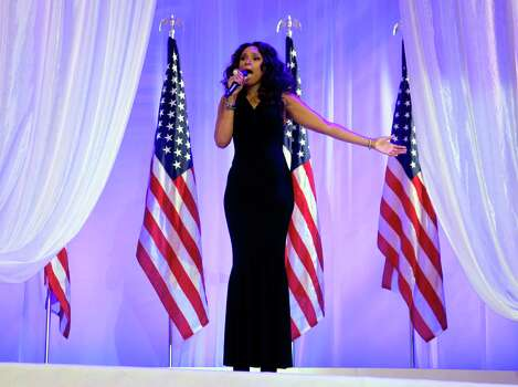 Jennifer Hudson sings as President Barack Obama and first lady Michelle Obama dance together at an Inaugural Ball. Photo: AP