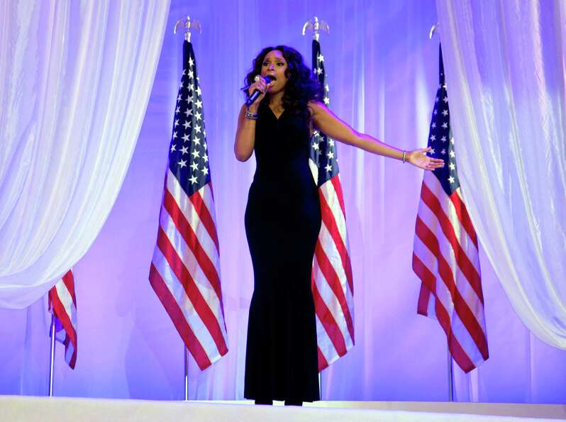Jennifer Hudson sings as President Barack Obama and first lady Michelle Obama dance together at an I