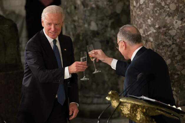 WASHINGTON, DC - JANUARY 21:  U.S. Vice President Joe Biden toasts with Sen. Charles Schumer, Chairman of the Joint Congressional Committee on Inaugural Ceremonies, at the Inaugural Luncheon in Statuary Hall on inauguration day at the U.S. Capitol building January 21, 2013 in Washington D.C.  Biden and U.S. President Barack Obama were ceremonially sworn in for their second term today. (Photo by Allison Shelley/Getty Images) Photo: Allison Shelley
