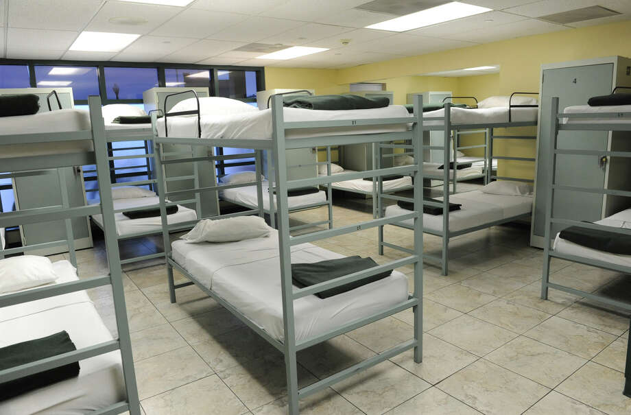 Beds in this smaller dorm room at the Capitol City Rescue Mission will be full tonight due to freezing temperatures on Monday Jan. 21, 2013 in Albany, N.Y.  (Lori Van Buren / Times Union) Photo: Lori Van Buren