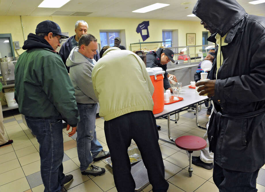 A large amount of homeless people gather in the cafeteria for snacks and drinks at the Capitol City Rescue Mission on Monday Jan. 21, 2013 in Albany, N.Y. The larger than normal number of people is due to freezing temperatures outside. (Lori Van Buren / Times Union) Photo: Lori Van Buren