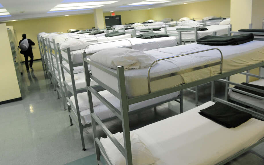 All sixty beds in this larger dorm room at the Capitol City Rescue Mission will be full tonight due to freezing temperatures on Monday Jan. 21, 2013 in Albany, N.Y.  (Lori Van Buren / Times Union) Photo: Lori Van Buren