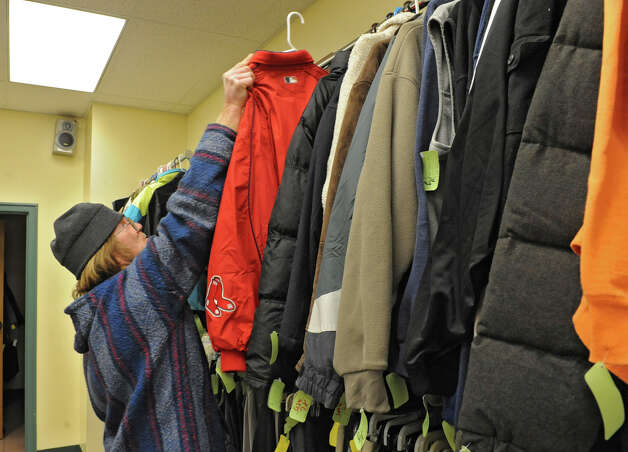 Resident and volunteer Ron Simpson organizes winter coats that will be given out at the Capitol City Rescue Mission on Monday Jan. 21, 2013 in Albany, N.Y.  (Lori Van Buren / Times Union) Photo: Lori Van Buren