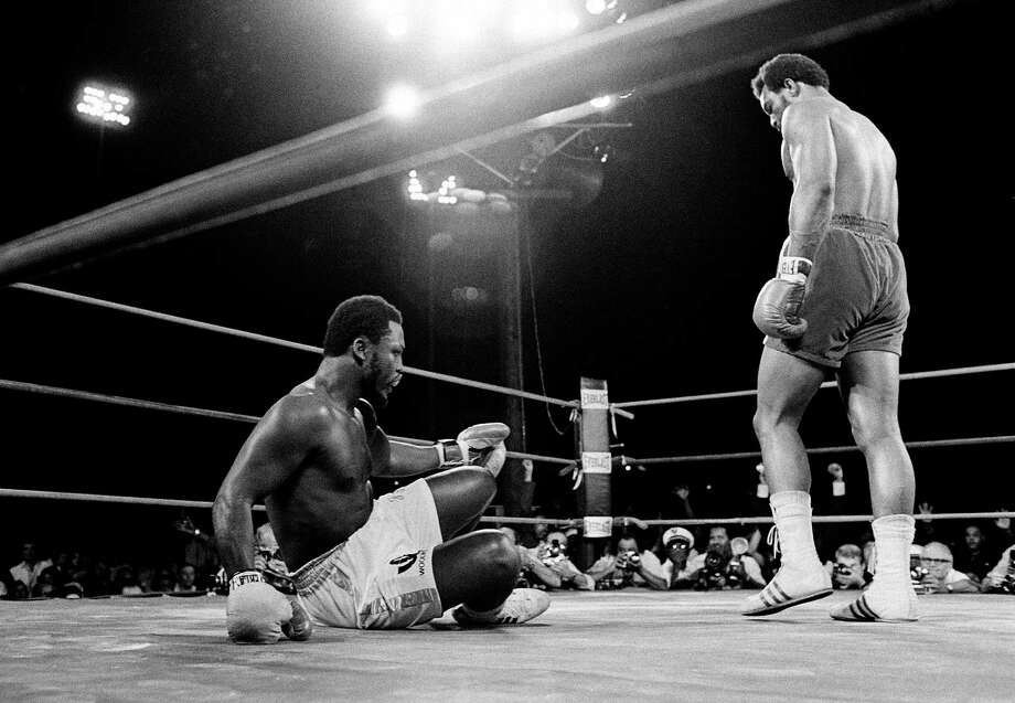 George Foreman, right, sent Joe Frazier to the canvas six times in less than two rounds to claim Frazier's heavyweight championship in a bout at Kingston, Jamaica, on Jan. 22, 1973. Foreman, who was 24 at the time, would retire in 1977 but come back to win a share of the title in 1994 at age 45. / AP1973