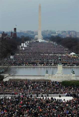 Crowds congregate in The National Mall for the ceremonial swearing-in for President Barack Obama at the U.S. Capitol during the 57th Presidential Inauguration in Washington, Monday, Jan. 21, 2013. (AP Photo/Susan Walsh) Photo: Susan Walsh