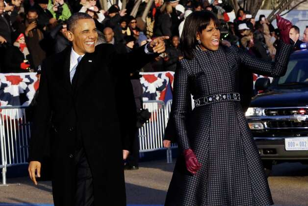President Barack Obama and first lady Michelle Obama walk in the Inaugural Parade during the 57th Presidential Inauguration in Washington, Monday, Jan. 21, 2013. (AP Photo/Charles Dharapak) Photo: Charles Dharapak