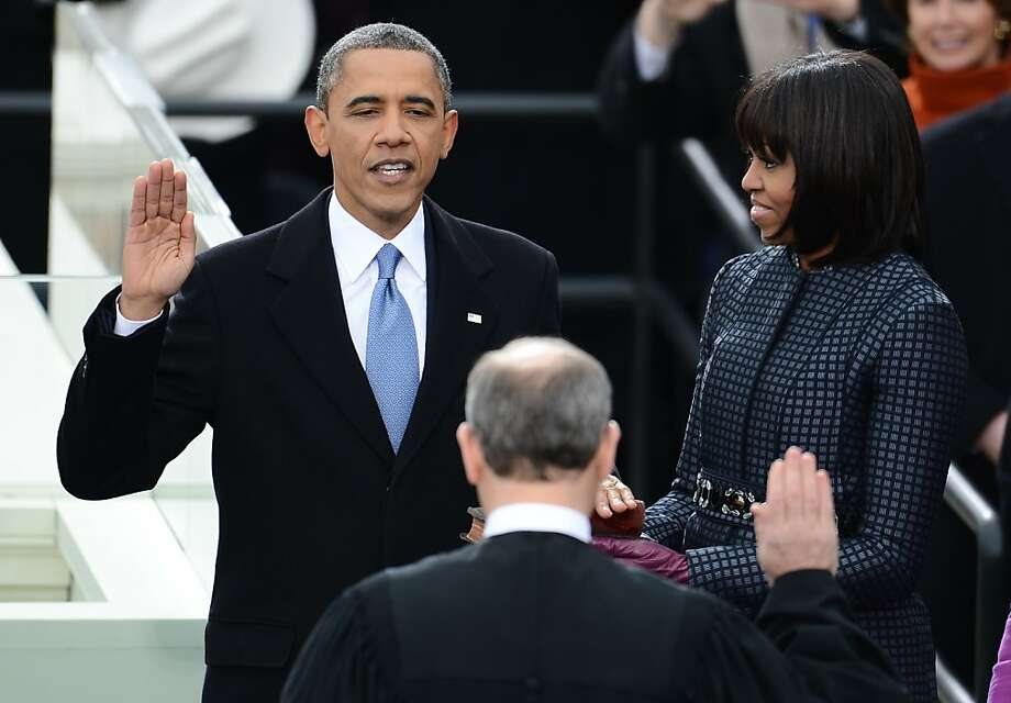 US President Barack Obama takes the oath of office during the 57th Presidential Inauguration ceremonial swearing-in at the US Capitol on January 21, 2013 in Washington, DC. The oath is administered by US Supreme Court Chief Justice John Roberts, Jr. Obama is joined by US First Lady Michelle Obama.    AFP PHOTO/Emmanuel DunandEMMANUEL DUNAND/AFP/Getty Images Photo: Emmanuel Dunand, AFP/Getty Images