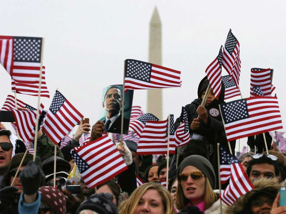 WASHINGTON, DC - JANUARY 21:  People listen as President Barack Obama speaks during his public ceremonial swearing-in ceremony as they stand on the National Mall during the Inauguration ceremony on January 21, 2013 in Washington, DC.  The President was sworn in for second term.  (Photo by Joe Raedle/Getty Images) Photo: Joe Raedle