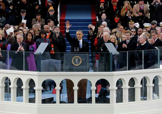 President Barack Obama waves to crowd after his Inaugural speech at the ceremonial swearing-in on the West Front of the U.S. Capitol during the 57th Presidential Inauguration in Washington, Monday, Jan. 21, 2013. (AP Photo/Scott Andrews, Pool) Photo: Scott Andrews Pool