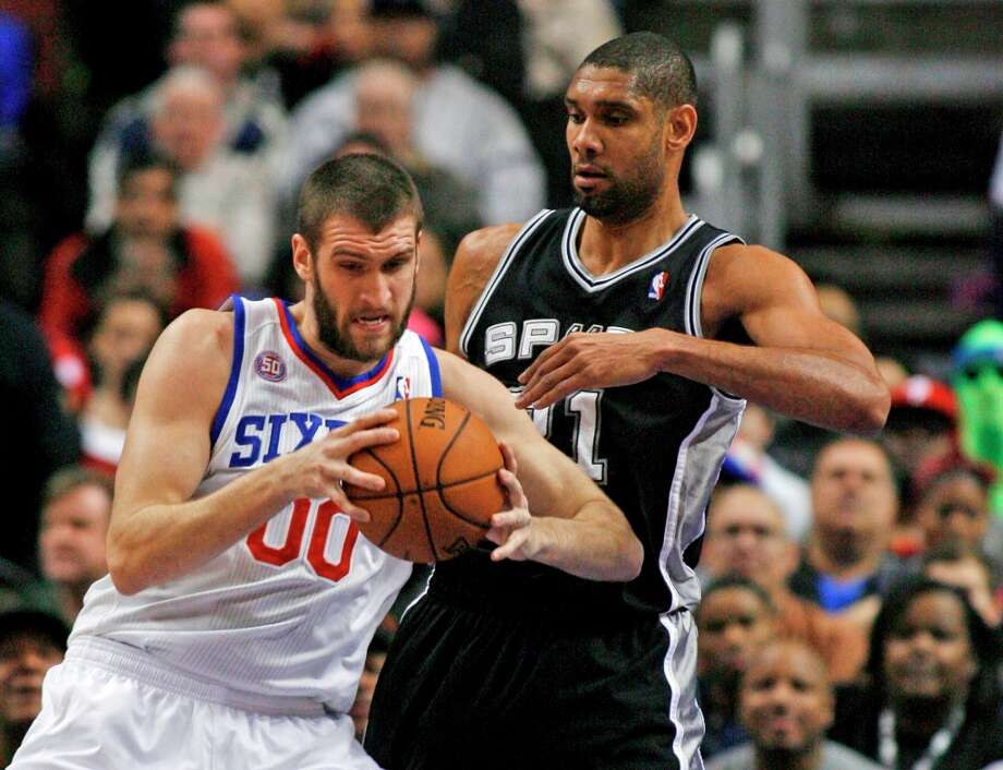 San Antonio Spurs' Tim Duncan defends as Philadelphia 76ers' Spencer Hawes (00) looks to pass in the first half of an NBA basketball game Monday Jan. 21, 2013, in Philadelphia. (AP Photo H. Rumph Jr) Photo: H. Rumph Jr, Associated Press / FR61717 AP