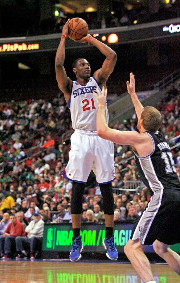 The Spurs' Matt Bonner  defends as Philadelphia 76ers' Thaddeus Young (21) shoots during the first half  Monday Jan. 21, 2013, in Philadelphia. Photo: H. Rumph Jr, Associated Press / FR61717 AP