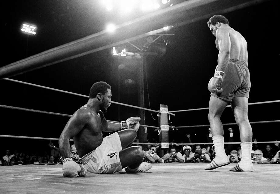 George Foreman, right, sent Joe Frazier to the canvas six times in less than two rounds to claim Frazier's heavyweight championship in a bout at Kingston, Jamaica, on Jan. 22, 1973. Foreman, who was 24 at the time, would retire in 1977 but come back to win a share of the title in 1994 at age 45.