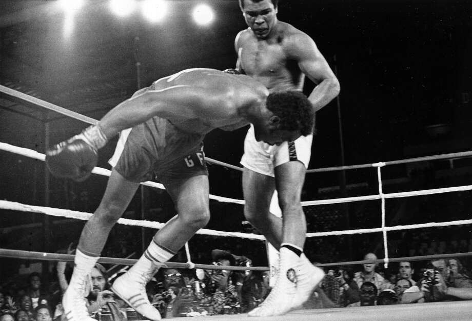 "On Oct. 30, 1974, challenger Muhammad Ali watched defending world champion George Foreman go down to the canvas in the eighth round of their boxing match in Kinshasa, Zaire. Ali regained the world heavyweight crown at the fight, dubbed ""Rumble in the Jungle."""