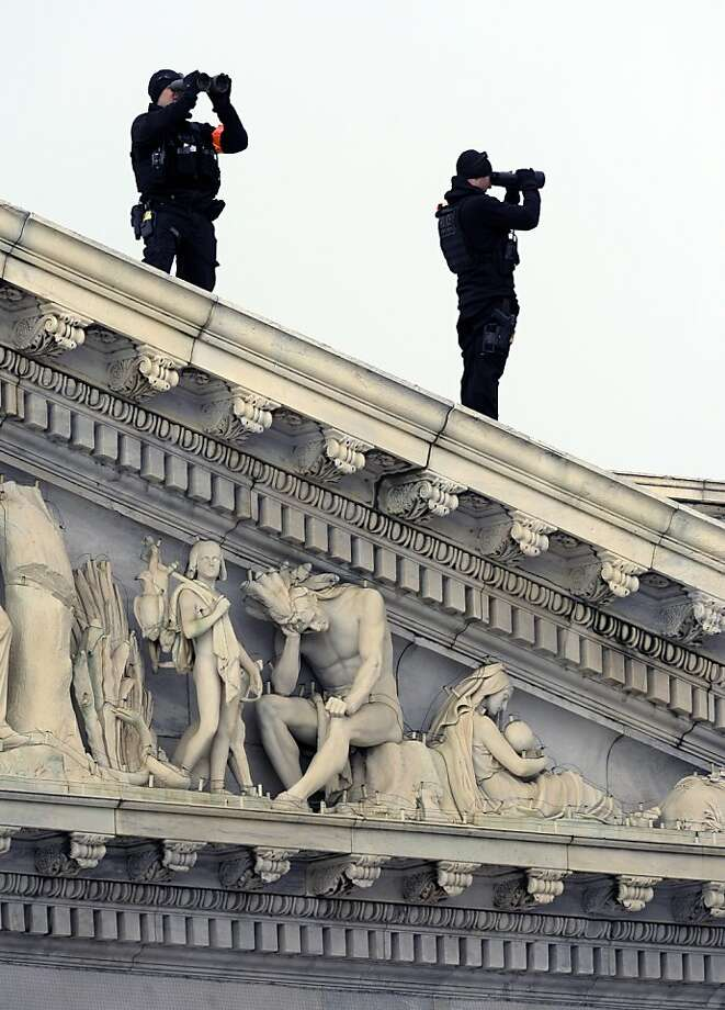 A U.S. Secret Service Counter Sniper Team scans the horizon from atop the U.S. Capitol during the 57th Presidential Inauguration in Washington, Monday, Jan. 21, 2013. (AP Photo/Cliff Owen) Photo: Cliff Owen, Associated Press