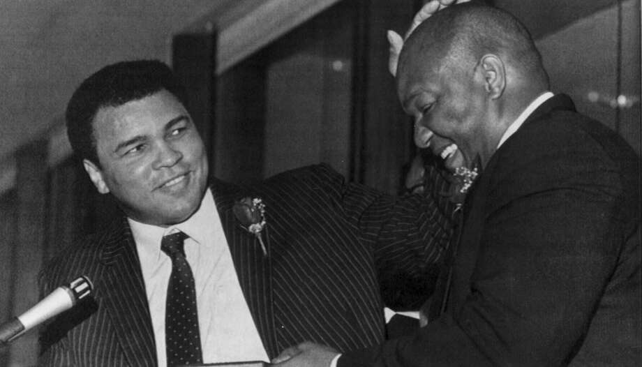 Eleven years after the epic battle, there were no hard feelings. Ali and Foreman are shown clowning around at a 1985 Galveston event honoring boxing legend Jack Johnson, the Isle native who became the first black world heavyweight champion.