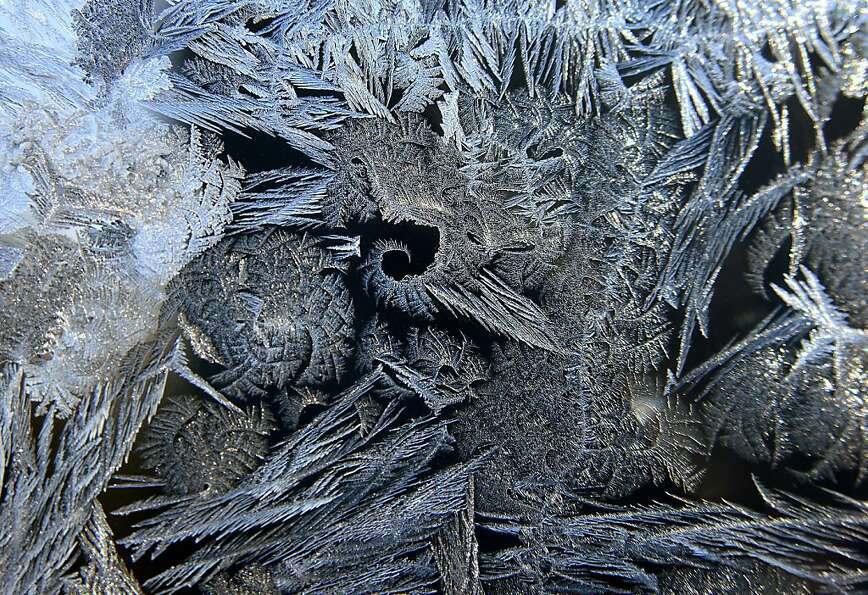 Why we don't live in Minnesota: Ice crystals frost a window of a home in Medina, Minn., where