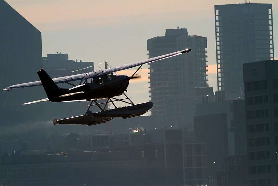 A plane flies in the South Lake Union district area of Seattle, Wash., Jan. 3, 2013. Float planes that take off and land on Lake Union have more tall buildings to contend with as the South Lake Union district is developed. Photo: Mark Harrison, Associated Press