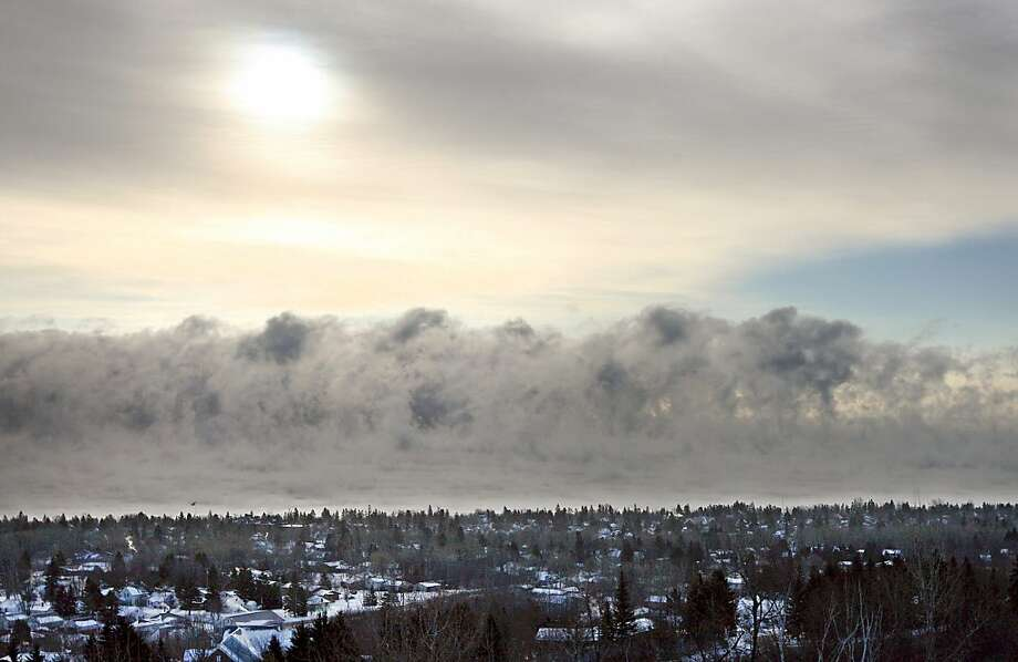 Fog forms over Lake Superior on Monday, Jan. 21, 2013, along the Duluth, Mich. shoreline as the area experiences subzero temperatures. Photo: Bob King, Associated Press