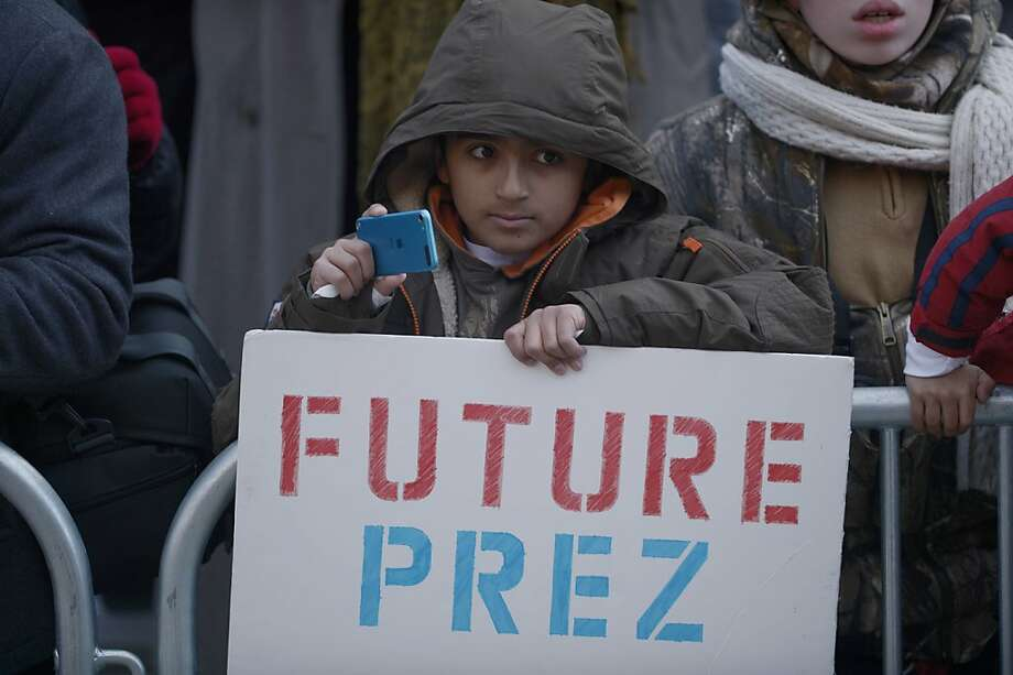 A boy watched the Inaugural Parade on January 21, 2013 in Washington, DC. Photo: Brendan Smialowski, AFP/Getty Images