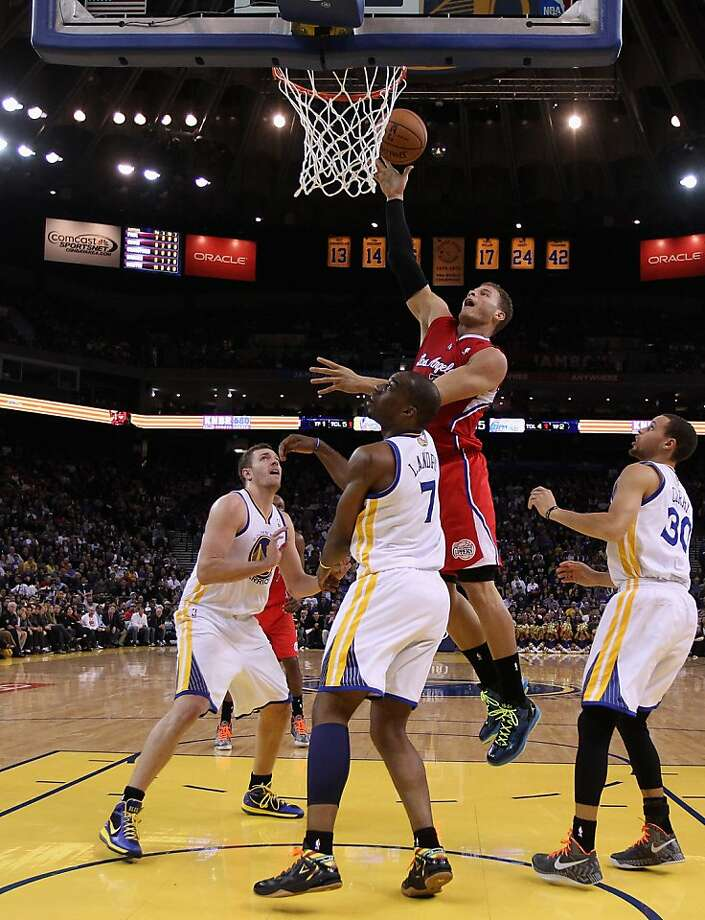 OAKLAND, CA - JANUARY 21: Blake Griffin #32 of the Los Angeles Clippers shoots over Carl Landry #7 of the Golden State Warriors at Oracle Arena on January 21, 2013 in Oakland, California. NOTE TO USER: User expressly acknowledges and agrees that, by downloading and or using this photograph, User is consenting to the terms and conditions of the Getty Images License Agreement.  (Photo by Ezra Shaw/Getty Images) Photo: Ezra Shaw, Getty Images