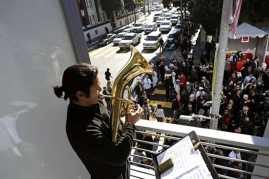 Members of the Jacob Garchik Brass Choir play on the second level balcony of the Jazz Center for the crowds gathered below.  Grand opening of the new SF Jazz Center on Franklin Street in San Francisco, CA Monday January 21st, 2013. Photo: Michael Short, Special To The Chronicle