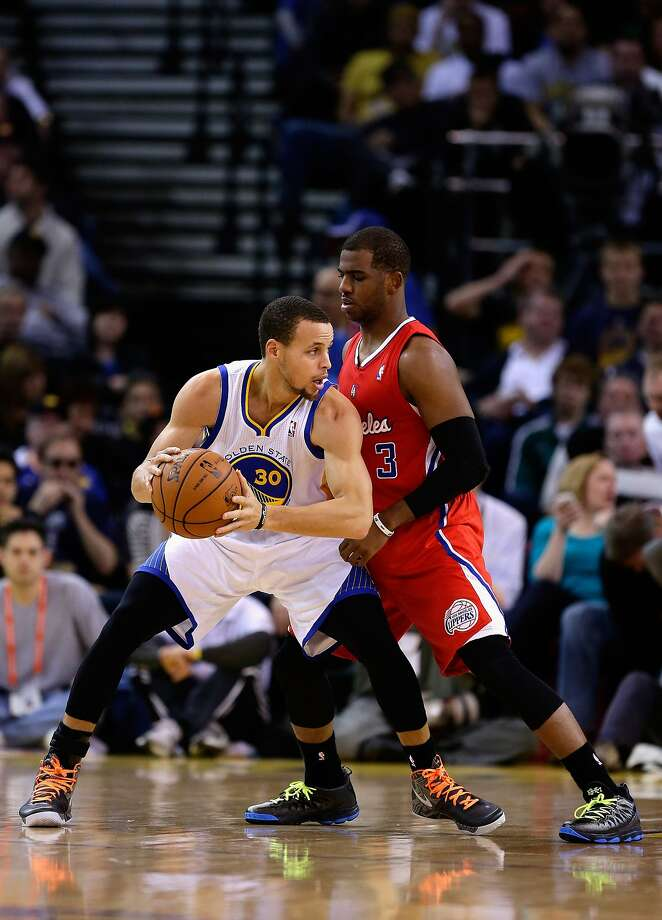 OAKLAND, CA - JANUARY 21:  Stephen Curry #30 of the Golden State Warriors is guarded by Chris Paul #3 of the Los Angeles Clippers at Oracle Arena on January 21, 2013 in Oakland, California. NOTE TO USER: User expressly acknowledges and agrees that, by downloading and or using this photograph, User is consenting to the terms and conditions of the Getty Images License Agreement.  (Photo by Ezra Shaw/Getty Images) Photo: Ezra Shaw, Getty Images