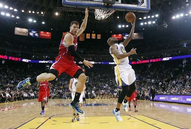 Golden State Warriors' Jarrett Jack, right, scores past Los Angeles Clippers' Blake Griffin, left, during the second half of an NBA basketball game in Oakland, Calif., Monday, Jan. 21, 2013. Golden State won 106-99. (AP Photo/Marcio Jose Sanchez) Photo: Marcio Jose Sanchez, Associated Press