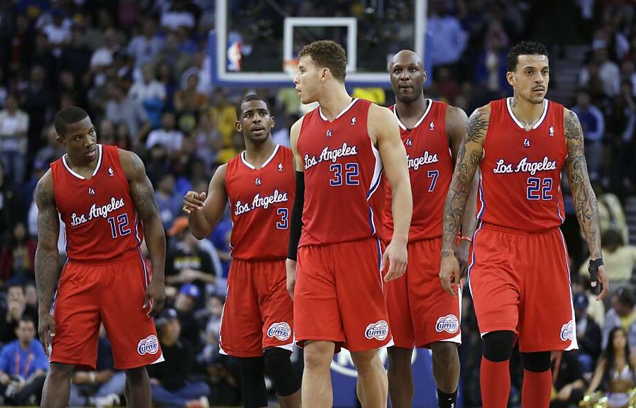 Los Angeles Clippers' Eric Bledsoe (12), Chris Paul (3), Blake Griffin (32), Lamar Odom (7) and Matt Barnes (22) confer in the closing minutes of the Clippers' 106-99 loss to the Golden State Warriors in an NBA basketball game in Oakland, Calif., Monday, Jan. 21, 2013. (AP Photo/Marcio Jose Sanchez) Photo: Marcio Jose Sanchez, Associated Press