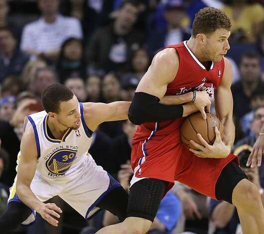 Golden State Warriors' Stephen Curry (30) reaches for the ball held by Los Angeles Clippers' Blake Griffin during the second half of an NBA basketball game in Oakland, Calif., Monday, Jan. 21, 2013. Golden State won 106-99. (AP Photo/Marcio Jose Sanchez) Photo: Marcio Jose Sanchez, Associated Press
