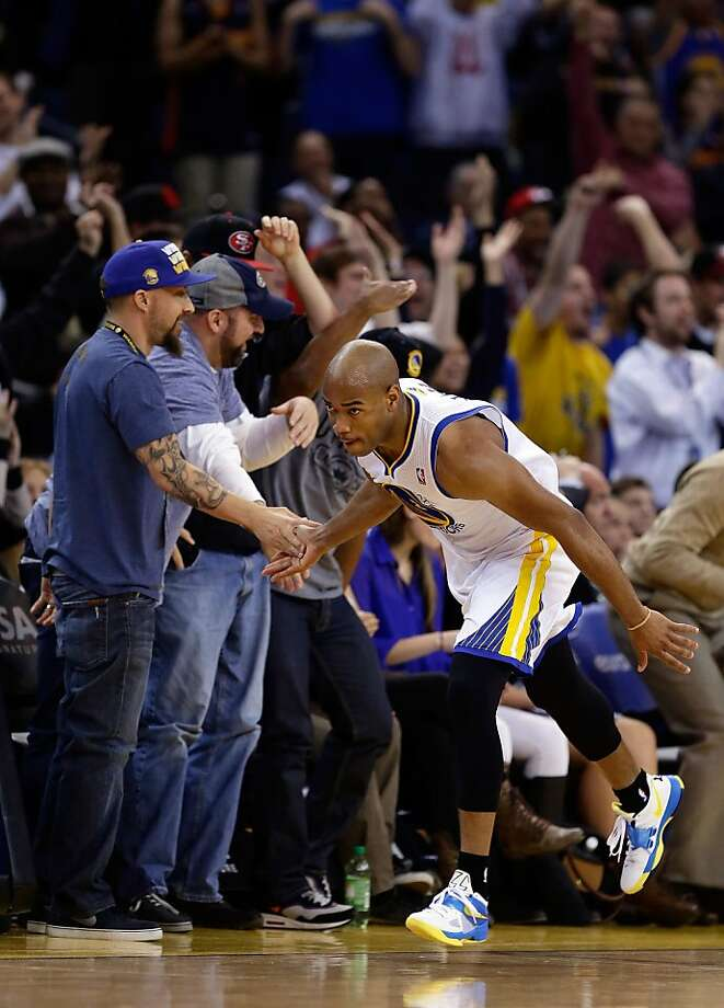 OAKLAND, CA - JANUARY 21:  Jarrett Jack #2 of the Golden State Warriors high-fives with the fans after making a basket against the Los Angeles Clippers at Oracle Arena on January 21, 2013 in Oakland, California. NOTE TO USER: User expressly acknowledges and agrees that, by downloading and or using this photograph, User is consenting to the terms and conditions of the Getty Images License Agreement.  (Photo by Ezra Shaw/Getty Images) Photo: Ezra Shaw, Getty Images