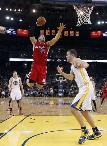 Los Angeles Clippers' Blake Griffin (32) goes up for a dunk next to Golden State Warriors' David Lee, right, as Klay Thompson (11) watches during the first half of an NBA basketball game in Oakland, Calif., Monday, Jan. 21, 2013. (AP Photo/Marcio Jose Sanchez) Photo: Marcio Jose Sanchez, Associated Press