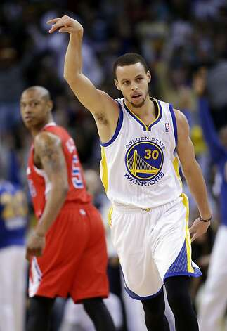 Golden State Warriors' Stephen Curry (30) gestures after hitting a 3-point basket as Los Angeles Clippers' Caron Butler (5) looks back during the first half of an NBA basketball game in Oakland, Calif., Monday, Jan. 21, 2013. (AP Photo/Marcio Jose Sanchez) Photo: Marcio Jose Sanchez, Associated Press