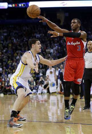Los Angeles Clippers' Chris Paul (3) passes over Golden State Warriors' Klay Thompson during the first half of an NBA basketball game in Oakland, Calif., Monday, Jan. 21, 2013. (AP Photo/Marcio Jose Sanchez) Photo: Marcio Jose Sanchez, Associated Press
