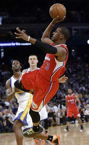 Los Angeles Clippers' Chris Paul (3) scores on an off-balance shot against the Golden State Warriors during the first half of an NBA basketball game in Oakland, Calif., Monday, Jan. 21, 2013. (AP Photo/Marcio Jose Sanchez) Photo: Marcio Jose Sanchez, Associated Press