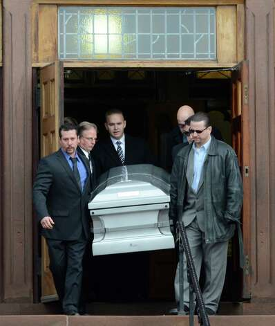 The casket carrying the remains of Lauren Tanski who was allegedly murdered in New Orleans are carried from the Blessed Sacrament Church Jan. 21, 2013,  in Albany, N.Y.     (Skip Dickstein/Times Union) Photo: SKIP DICKSTEIN / 00020834A
