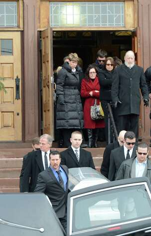 Mourners follow the casket carrying the remains of Lauren Tanski who was allegedly murdered in New Orleans are carried from the Blessed Sacrament Church Jan. 21, 2013,  in Albany, N.Y.     (Skip Dickstein/Times Union) Photo: SKIP DICKSTEIN / 00020834A