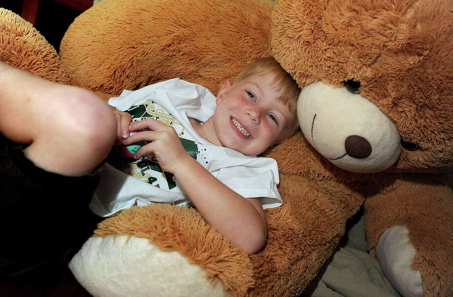 Nicknamed the Bear, Indy Parkhurst rolls around in his stuffed bear Indy Jr. Guiseppe Barranco/The Enterprise Photo: Guiseppe Barranco
