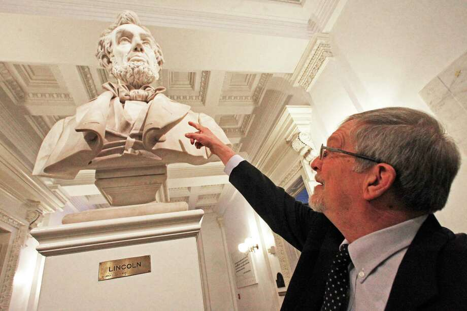"Civil War historian Howard Coffin points to the marble bust of Abraham Lincoln on Thursday, Jan. 17, 2013 in Montpelier, Vt. This year is the 150th anniversary of the Gettysburg Address, and the Stephen Spielberg movie ""Lincoln,"" is widely considered a strong contender for an Academy Award as best picture. That makes it a good time to ask lawmakers to include sprucing up Vermont's Lincoln in their budget, Coffin said. (AP Photo/Toby Talbot) Photo: Toby Talbot"